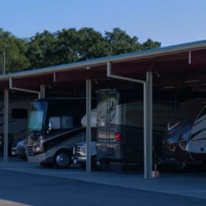Class A motorhomes parked under covered outdoor RV storage