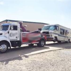 Class A motorhome being towed by a RV tow truck