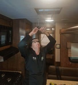 Mobile RV technician repairing RV air conditioner